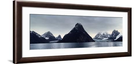 A Cone-Shaped Mountain Rises from the Dark Waters of an Arctic Fjord Beneath a Storm Laden Sky-Jason Edwards-Framed Art Print