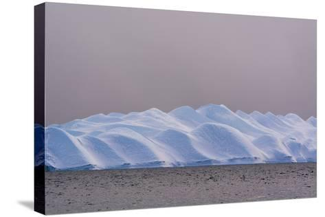 An Iceberg in Ilulissat Icefjord, an UNESCO World Heritage Site, on a Cloudy Day-Sergio Pitamitz-Stretched Canvas Print