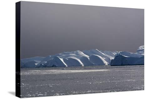 Icebergs and Melting Pack Ice in Ilulissat Icefjord, an UNESCO World Heritage Site-Sergio Pitamitz-Stretched Canvas Print