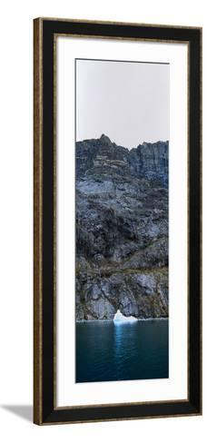 An Iceberg Carved from a Glacier Floating in the Dark Waters of an Arctic Fjord-Jason Edwards-Framed Art Print