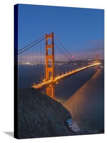 Lights on the Golden Gate Bridge at Night-Jeff Mauritzen-Stretched Canvas Print