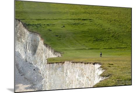 A Mountain Bike Cycling the South Downs Way Near Cliffs at Beachy Head-Alex Treadway-Mounted Photographic Print