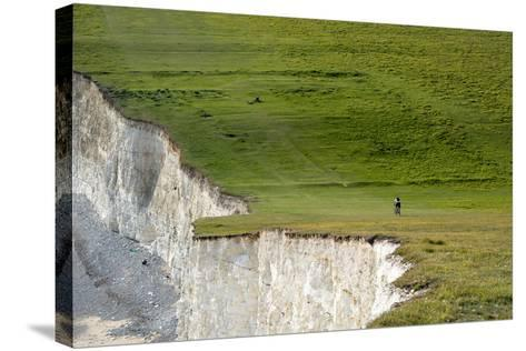 A Mountain Bike Cycling the South Downs Way Near Cliffs at Beachy Head-Alex Treadway-Stretched Canvas Print