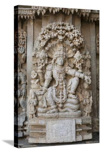 An Elaborate Carving of the Hindu God Vishnu-Kelley Miller-Stretched Canvas Print