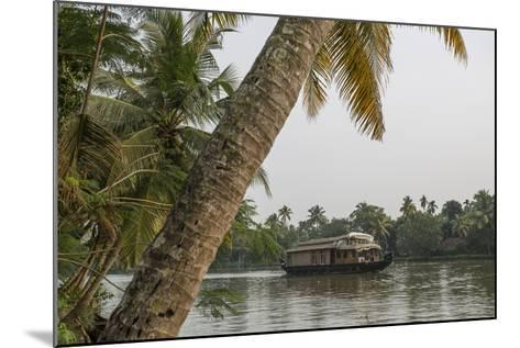 A Houseboat Carries Locals and Tourists Through the Backwaters-Kelley Miller-Mounted Photographic Print