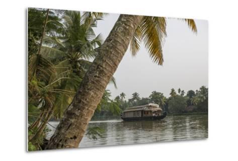 A Houseboat Carries Locals and Tourists Through the Backwaters-Kelley Miller-Metal Print