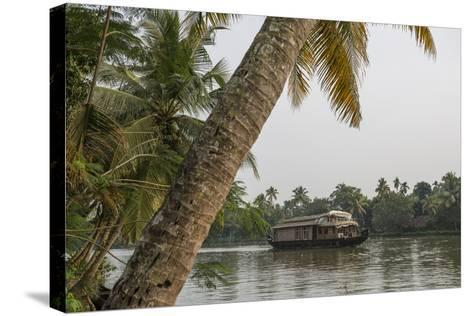 A Houseboat Carries Locals and Tourists Through the Backwaters-Kelley Miller-Stretched Canvas Print