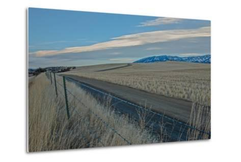 A Road Cuts Through Harvested Wheat Fields as Lenticular Clouds Hover over the Bridger Mountains-Gordon Wiltsie-Metal Print