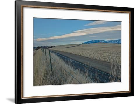 A Road Cuts Through Harvested Wheat Fields as Lenticular Clouds Hover over the Bridger Mountains-Gordon Wiltsie-Framed Art Print