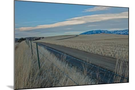 A Road Cuts Through Harvested Wheat Fields as Lenticular Clouds Hover over the Bridger Mountains-Gordon Wiltsie-Mounted Photographic Print