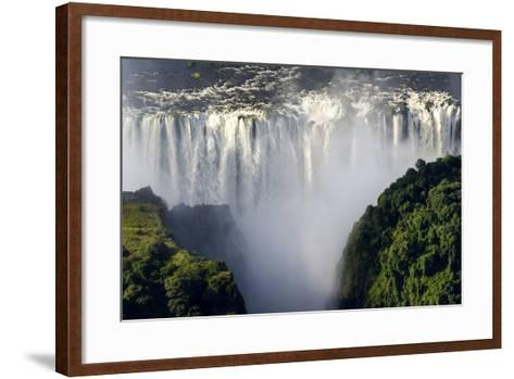 The Flooded Waters of the Zambezi River Cascade in a Curtain across the Face of Victoria Falls-Jason Edwards-Framed Art Print