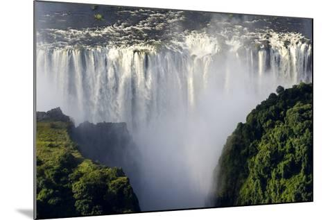 The Flooded Waters of the Zambezi River Cascade in a Curtain across the Face of Victoria Falls-Jason Edwards-Mounted Photographic Print