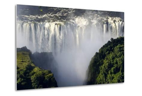 The Flooded Waters of the Zambezi River Cascade in a Curtain across the Face of Victoria Falls-Jason Edwards-Metal Print