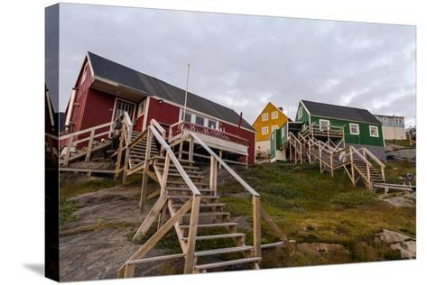 Stairs Lead to Cottages Perched on Rocky Outcrops in an Arctic Village-Jason Edwards-Stretched Canvas Print
