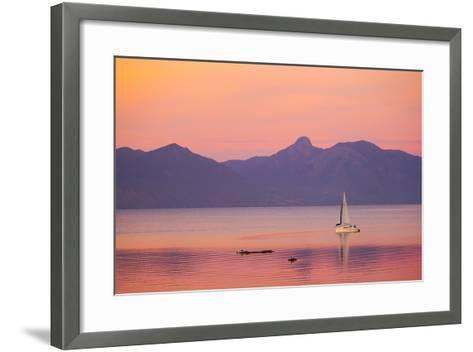 A Sailboat in Lake Villarrica's Flat Calm Water with Small Ripples, at Sunset-Mike Theiss-Framed Art Print