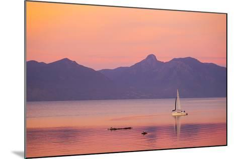 A Sailboat in Lake Villarrica's Flat Calm Water with Small Ripples, at Sunset-Mike Theiss-Mounted Photographic Print