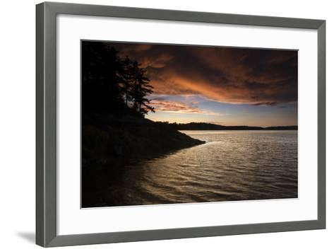 Turbulent Clouds over Water are Cast with Fiery Yellows and Oranges at Sunset-Robbie George-Framed Art Print