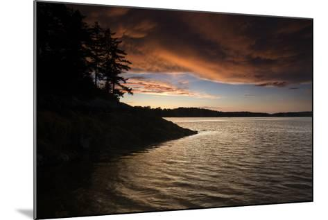 Turbulent Clouds over Water are Cast with Fiery Yellows and Oranges at Sunset-Robbie George-Mounted Photographic Print