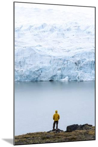 A Hiker Dwarfed by the Fracture Zone of a Glacier on the Greenland Ice Sheet-Jason Edwards-Mounted Photographic Print