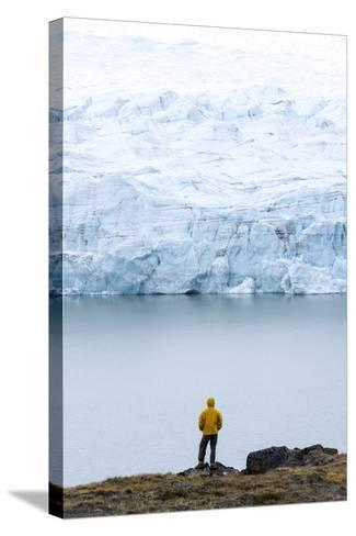 A Hiker Dwarfed by the Fracture Zone of a Glacier on the Greenland Ice Sheet-Jason Edwards-Stretched Canvas Print