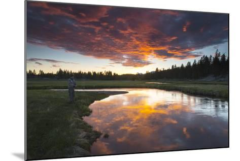 A Fisherman Tries His Luck under a Radiant Sky at Dusk-Robbie George-Mounted Photographic Print