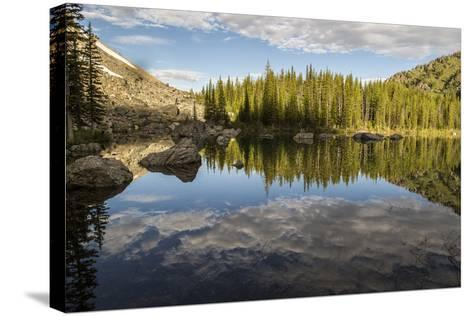 A Beautiful Alpine Lake Glows in the Morning Light, Deep in the Swan Mountain Range-Ami Vitale-Stretched Canvas Print