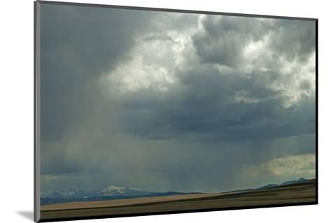 Rain Squalls Hover over Lonely Prairies, Ranchlands and Mountains North of Three Forks, Montana-Gordon Wiltsie-Mounted Photographic Print