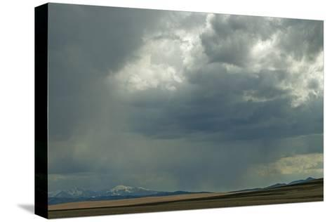 Rain Squalls Hover over Lonely Prairies, Ranchlands and Mountains North of Three Forks, Montana-Gordon Wiltsie-Stretched Canvas Print
