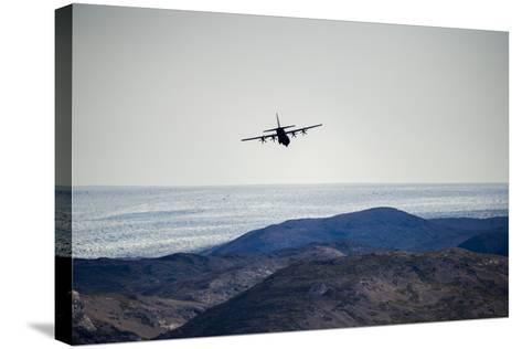 A Military Hercules Plane Flying Low over the Greenland Ice Sheet-Jason Edwards-Stretched Canvas Print