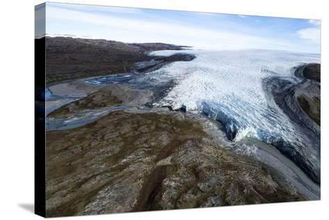 A River of Meltwater Flows from an Enormous Glacier into a Floodplain-Jason Edwards-Stretched Canvas Print