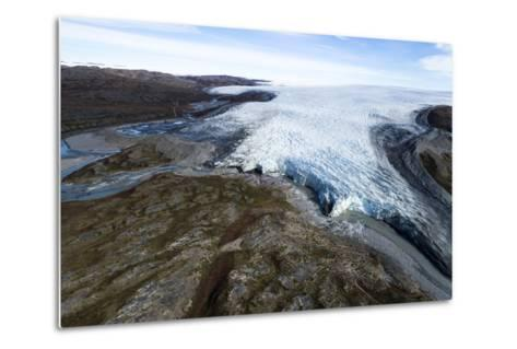 A River of Meltwater Flows from an Enormous Glacier into a Floodplain-Jason Edwards-Metal Print