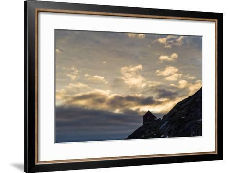 The Silhouette of a Cottage Perched on a Rocky Outcrop on an Arctic Island-Jason Edwards-Framed Art Print