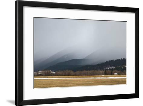 A Spring Storm Hovers over a Barn in Cottonwood Canyon of the Gallatin Range, Near Bozeman, Montana-Gordon Wiltsie-Framed Art Print