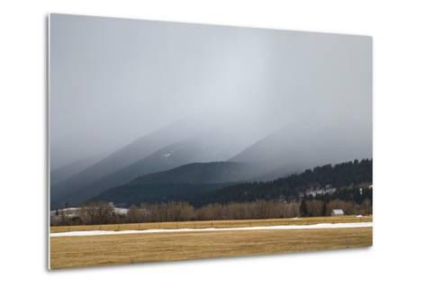 A Spring Storm Hovers over a Barn in Cottonwood Canyon of the Gallatin Range, Near Bozeman, Montana-Gordon Wiltsie-Metal Print