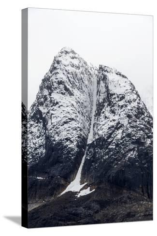 A Rugged Cone-Shaped Mountain Summit Dusted in Snow and Ice-Jason Edwards-Stretched Canvas Print