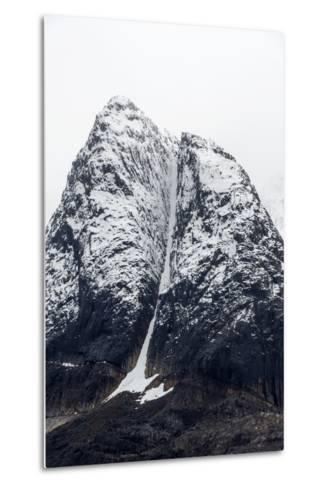 A Rugged Cone-Shaped Mountain Summit Dusted in Snow and Ice-Jason Edwards-Metal Print