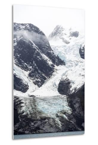 A Jagged Glacier Tongue Recedes Up and Rugged and Inhospitable Mountain Gorge in a Fiord-Jason Edwards-Metal Print