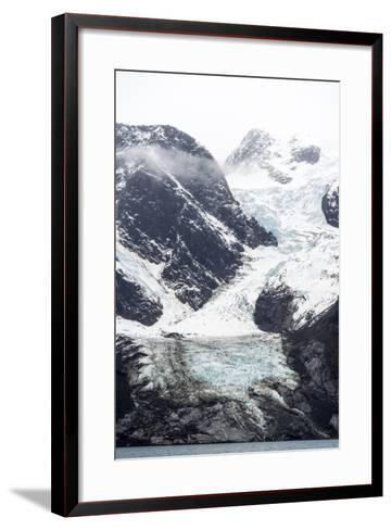 A Jagged Glacier Tongue Recedes Up and Rugged and Inhospitable Mountain Gorge in a Fiord-Jason Edwards-Framed Art Print