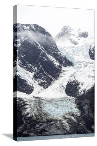 A Jagged Glacier Tongue Recedes Up and Rugged and Inhospitable Mountain Gorge in a Fiord-Jason Edwards-Stretched Canvas Print