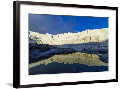 The Setting Sun Reflects the Sheer Ice Cliff of a Glacier Fracture Zone in a Pond-Jason Edwards-Framed Art Print