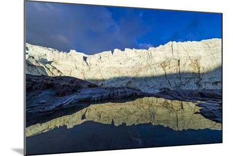 The Setting Sun Reflects the Sheer Ice Cliff of a Glacier Fracture Zone in a Pond-Jason Edwards-Mounted Photographic Print