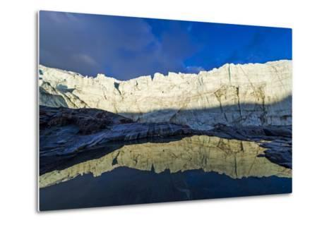 The Setting Sun Reflects the Sheer Ice Cliff of a Glacier Fracture Zone in a Pond-Jason Edwards-Metal Print