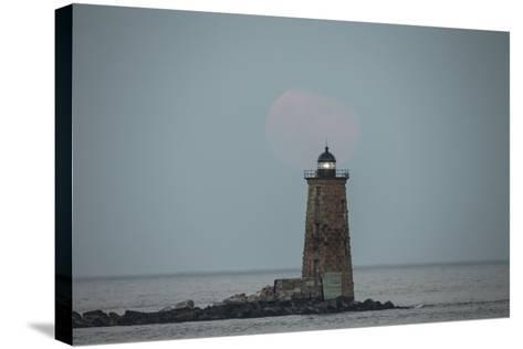 Whaleback Lighthouse Stands Out in the Night as the Supermoon Fades into the Evening-Robbie George-Stretched Canvas Print