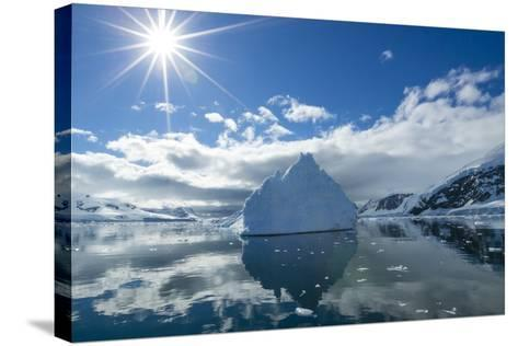 Reflections of Icebergs on Water in Niko Harbor, Antarctica-Ralph Lee Hopkins-Stretched Canvas Print