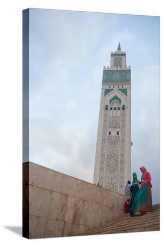 Women in Colorful Djelabas and Head Scarves Walk Down Stairs in Front of Hassan Ii Mosque, Morocco-Erika Skogg-Stretched Canvas Print