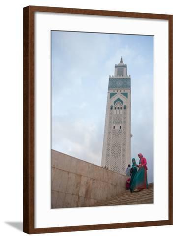 Women in Colorful Djelabas and Head Scarves Walk Down Stairs in Front of Hassan Ii Mosque, Morocco-Erika Skogg-Framed Art Print