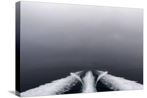 A Boat Wake Peels Out across the Still Waters of an Arctic Fjord-Jason Edwards-Stretched Canvas Print
