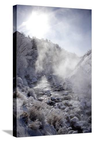 Steam Rising over the Snowy Banks of a Hot Spring-Robbie George-Stretched Canvas Print