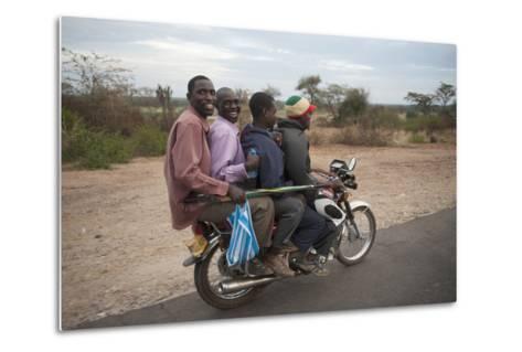 A Motorcycle Taxi Near the Town of Kasese in Uganda-Joel Sartore-Metal Print