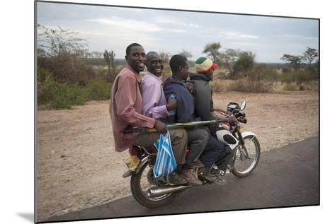 A Motorcycle Taxi Near the Town of Kasese in Uganda-Joel Sartore-Mounted Photographic Print